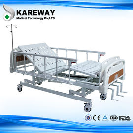 China Three Cranks Mechanical Hospital Bed With ABS Dining Table For Nursing Home supplier